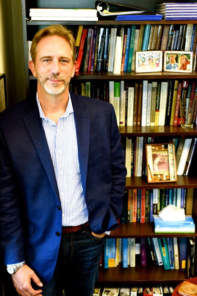 gushee standing at bookshelves aug 15