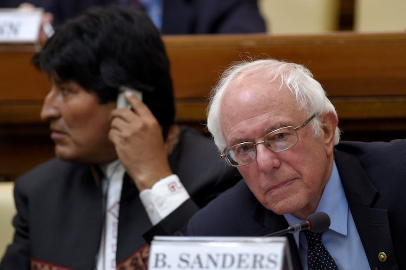 Democratic presidential candidate Bernie Sanders and Bolivia's president Evo Morales (L) attend a conference at the Vatican, April 15, 2016. Photo coutesy REUTERS/Gabriel Bouys