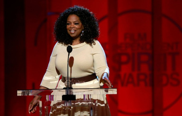 Entertainer and producer Oprah Winfrey arrives to introduce a clip from her Best Feature nominated film