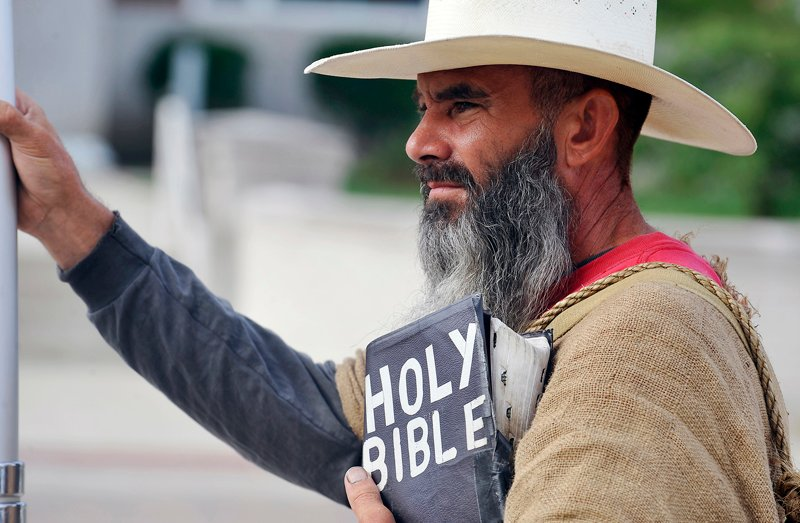 Allan Hoyle, of North Carolina, stands with bible in hand in support of Kim Davis at the Rowan County Judicial Center in Morehead, Kentucky, on September 9, 2015. Photo courtesy of REUTERS/Chris Tilley *Editors: This photo may only be republished with RNS-CHALLENGED-BOOKS, originally transmitted on April 12, 2016.