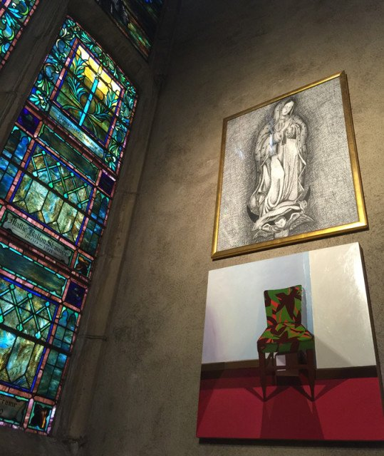 """First Congregational Church of Los Angeles presents """"Art & Spirit,"""" a gallery which includes the Virgin of Guadalupe hanging above an acrylic painting of a single upholstered chair. Religion News Service photo by Kimberly Winston"""