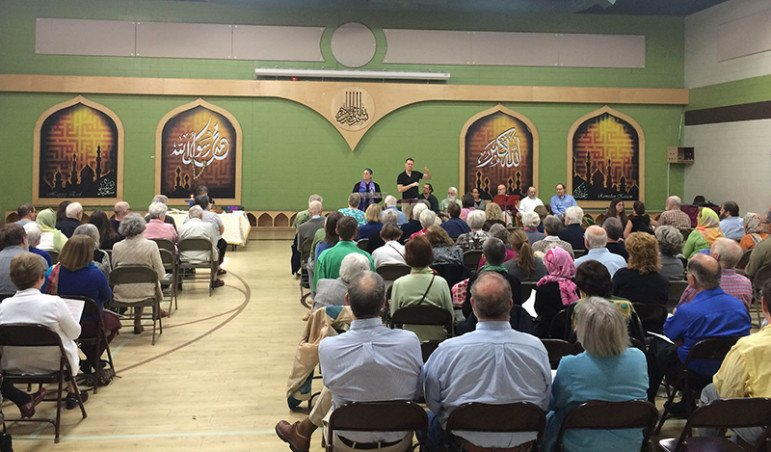 Worship of the Unitarian Universalist congregation held in the gymnasium of the Islamic Center of Greater Lansing. Photo courtesy of Corie Jason