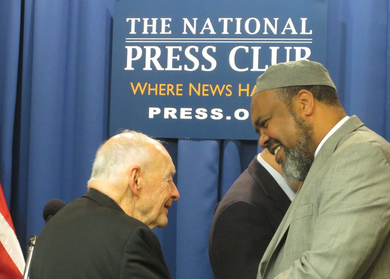 Cardinal Theodore McCarrick greets Former ISNA President Imam Mohamed Magid during a press conference pushing national political parties to reject anti-Muslim bigotry in the elections at National Press Club in Washington, D.C. on April. 14, 2016. Religion News Service photo by Aysha Khan