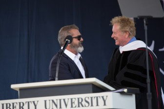 Actor Mel Gibson and screenwriter Randall Wallace at Liberty University's 43rd Commencement Ceremony on May 14, 2016. (Photo courtesy of Liberty University by Mitchell Bryant)