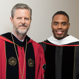 Liberty University president Jerry Falwell Jr. and New York Giants running back Rashad Jennings at the 2016 commencement ceremony. - Photo courtesy of Liberty University