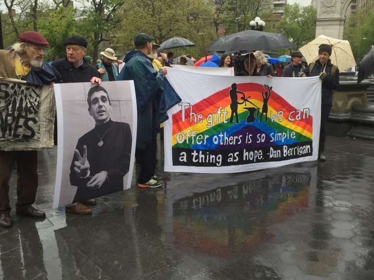 Funeral march for Rev. Daniel Berrigan.