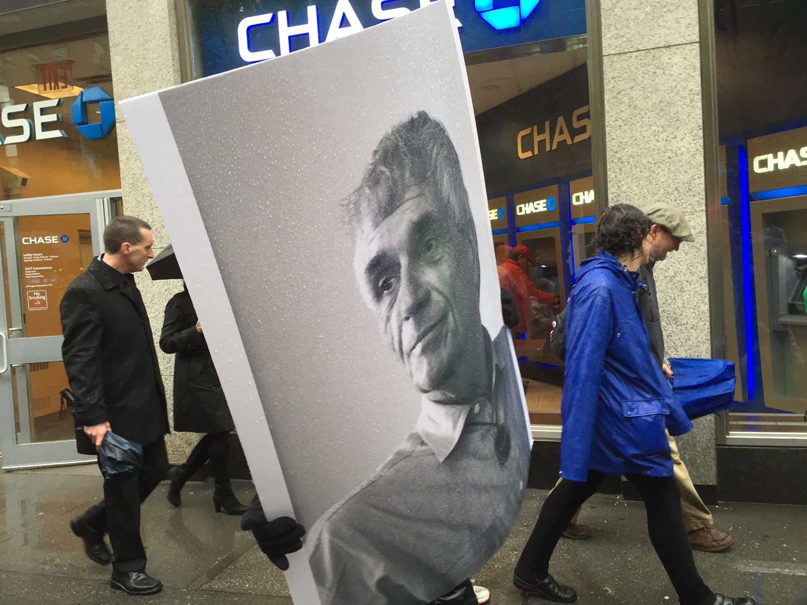 Mourners carry photo of priest and peace activist Rev. Daniel Berrigan