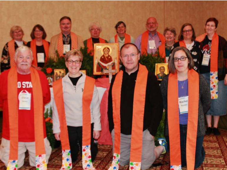 Clergy from the Episcopal Diocese of Ohio wear orange stoles ahead of Wear Orange Sunday on June 5, 2016. Back row: Mary L. Staley of St. Paul's, Put-in-Bay; Kay N. Ashby of St. Matthew's, Ashland; Brian K. Wilbert of Christ Church, Oberlin; June Hardy Dorsey of St. Andrew's, Elyria; Beth Frank of New Life, Uniontown; C. Eric Funston of St. Paul's, Ohio; Sarah Shofstall of St. Barnabas, Bay Village; Gayle L. Catinella of St John's, Youngstown; Rosalind Hughes of Epiphany, Euclid. Front Row: Stephen Secaur of St. Bartholomew, Mayfield Village; Mary C. Carson of Redeemer, Lorain; Christopher McCann of St. Luke's, Chardon; Rachel C. Kessler of Harcourt Parish, Gambier. Photo courtesy of the Rev. Jeff Bunke, Perrysburg, Ohio