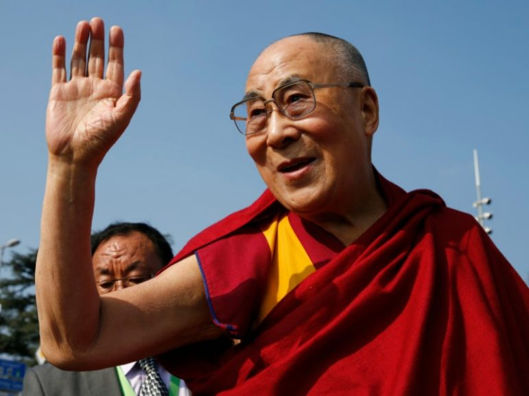 Tibetan spiritual leader the Dalai Lama waves to devotees March 11, 2016, outside the United Nations, where the Human Rights Council was holding its 31st session in Geneva. Photo courtesy of Denis Balibouse/Reuters