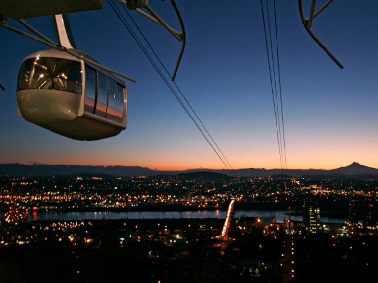 One of the two cars in the new aerial tram rises above Portland, Oregon, at sunrise. Photo courtesy REUTERS/Richard Clement Editors: This photo may be used with RNS-METHODIST-ISSUES published May 7, 2016.