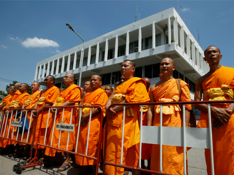Buddhist monks gather outside Khlongluang provincial police station