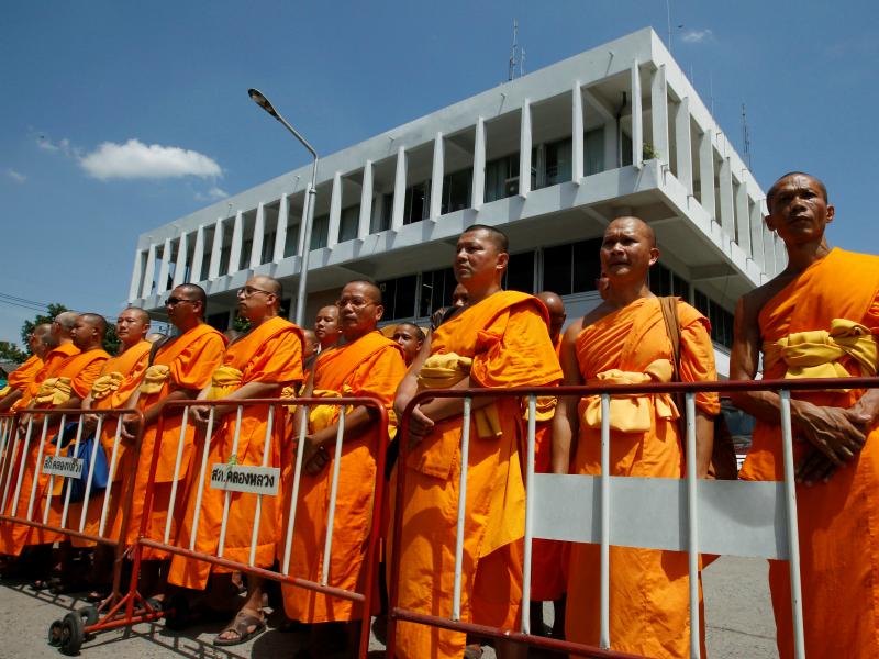 Buddhist monks gather outside Khlongluang provincial police station