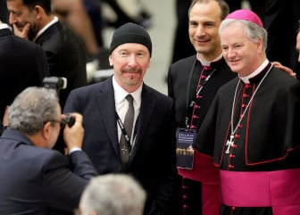 U2 guitarist David Evans, also known by his stage name The Edge, poses with Irish bishop Paul Tighe before listening to U.S. Vice President Joe Biden at the Vatican on April 29, 2016. Photo via REUTERS/Max Rossi.