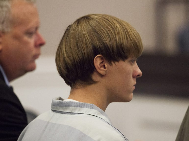 Dylann Roof, right, the 21-year-old man charged with murdering nine worshippers at a historic black church in Charleston, S.C., on June 17, 2015, listens to the proceedings with assistant defense attorney William Maguire during a hearing at the Judicial Center in Charleston on July 16, 2015. Photo courtesy REUTERS/Randall Hill *Editors: This photo may only be republished with RNS-CHARLESTON-ANNIVERSARY, originally transmitted on June 8, 2016.
