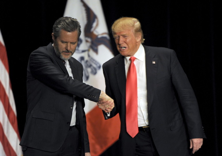 Republican presidential candidate Donald Trump shakes hands with co-headliner Jerry Falwell Jr., leader of the nation's largest Christian university, during a campaign event at the Orpheum Theatre in Sioux City, Iowa, on Jan. 31, 2016.