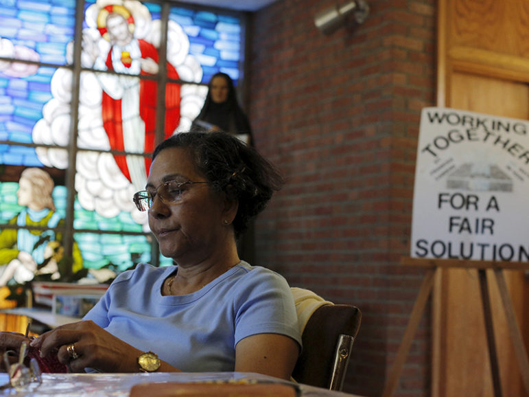 Parishioner Maria Alves knits while sitting vigil at St. Frances Xavier Cabrini Roman Catholic church in Scituate, Massachusetts on July 22, 2015. Photo courtesy of REUTERS/Brian Snyder/File Photo *Editors: This photo may only be republished with RNS-CHURCH-VIGIL, originally transmitted on May 20, 2016.