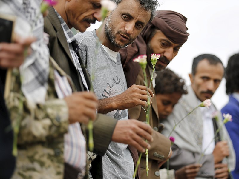 Members of the Baha'i faith hold flowers as they demonstrate outside a state security court during a hearing in the case of a fellow Baha'i man charged with seeking to establish a base for the community in Yemen, in the country's capital Sanaa April 3, 2016. Photo courtesy of REUTERS/Khaled Abdullah *Editors: This photo may only be republished with RNS-GEORGE-OPED, originally transmitted on May 13, 2016.
