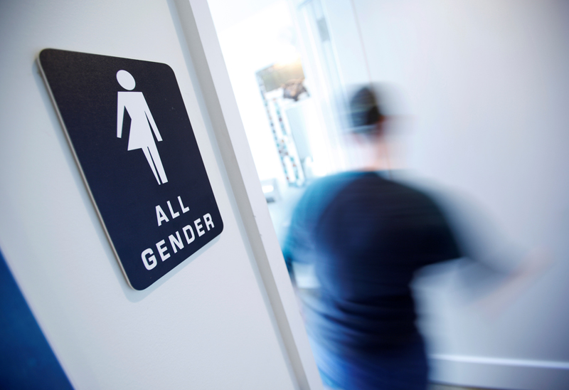 A bathroom sign welcomes both genders at the Cacao Cinnamon coffee shop in Durham, N.C., on May 3, 2016. Photo courtesy of REUTERS/Jonathan Drake/File Photo  *Editors: This photo may only be republished with RNS-GUTHRIE-SATIRE, originally transmitted on May 11, 2016.