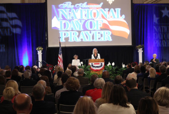 Hundreds gathered on Capitol Hill to observe the 65th National Day of Prayer. During the Washington event, Shirley Dobson, chair of the National Day of Prayer Task Force, seated on stage, announced that she would be succeeded by Anne Graham Lotz, at the podium. RNS photo by Adelle M. Banks