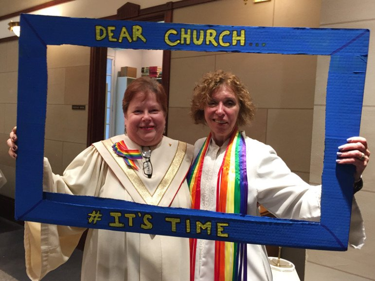 Peg Isaacson, left, chair of the Reconciling Ministries Task Force at First United Methodist Church at the Chicago Temple, and the Rev. Wendy A. Witt, one of the church's pastors, pose for a photo after its services on May 3, 2016, urging the then-upcoming United Methodist Church General Conference to recognize