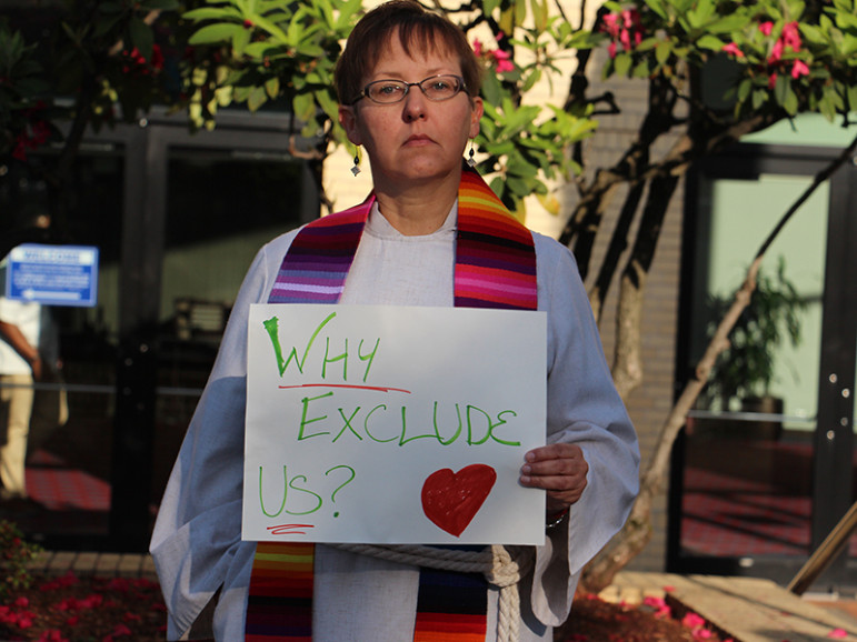 The Rev. Cynthia Meyer, a Kansas pastor who came out to her small congregation in January 2016, joins protesters outside of the United Methodist General Conference in Portland, Ore., on May 18, 2016. RNS photo by Emily McFarlan Miller