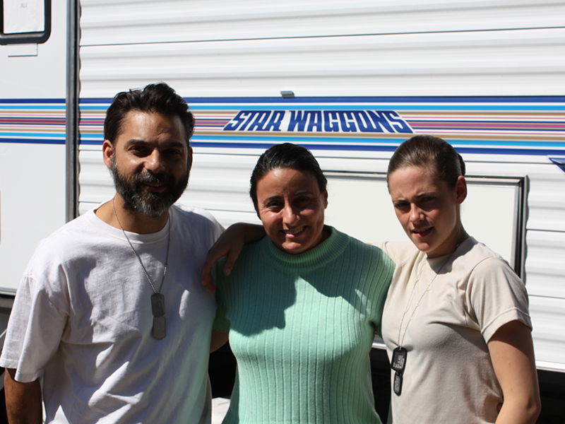 Actor Peyman Moaadi, Suhad Obeidi, Director of Operations and Head of the Hollywood Bureau, Muslim Public Affairs Council, and actor Kristen Stewart on the set of Camp X-Ray (2014). Photo courtesy of Suhad Obeidi