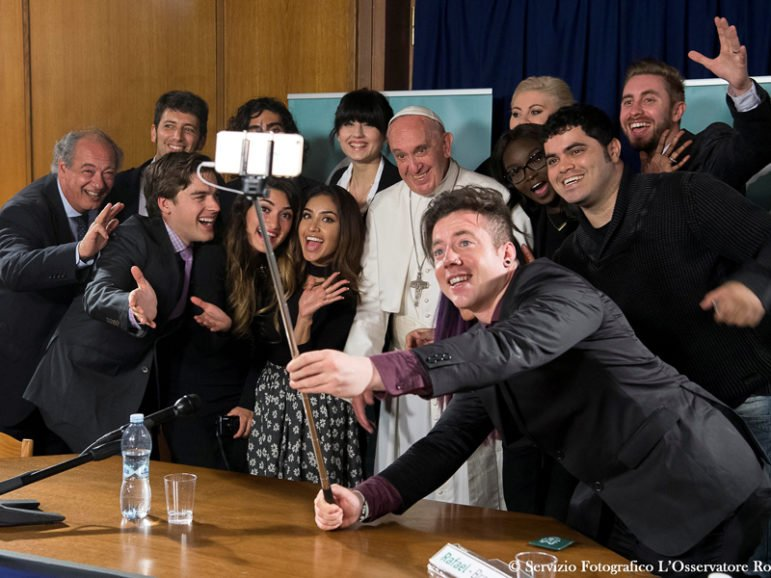 Pope Francis poses for a selfie picture during a meeting of the Scholas Occurrentes at the Vatican, on May 29, 2016. Photo courtesy of Osservatore Romano/ Handout via REUTERS *Editors: This photo may only be republished with RNS-POPE-SOCIAL, originally transmitted on May 30, 2016.