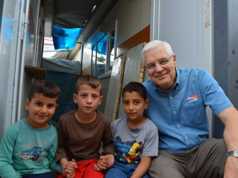 Rich Stearns, president of World Vision, U.S., sits with children in the Kurdish Region of Iraq, who have been displaced by the conflict in their country. Photo courtesy of World Vision/Kari Constanza
