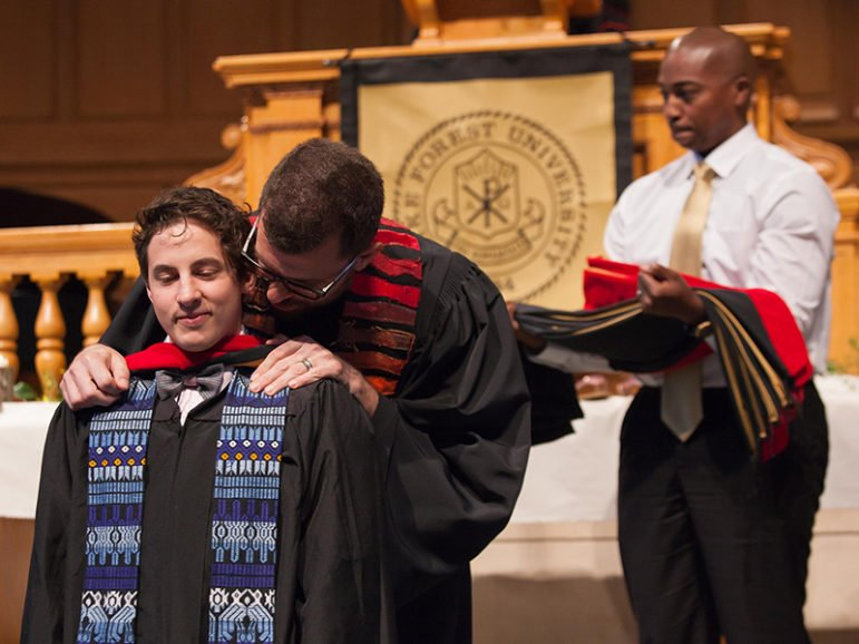 Adam Plant (M.Div. '16) receives his master's hood from the Rev. Christopher T. Copeland during the Wake Forest University School of Divinity's hooding ceremony on May 14, 2016 in Wait Chapel. Photo courtesy of Red Cardinal Studio, Wake Forest University School of Divinity