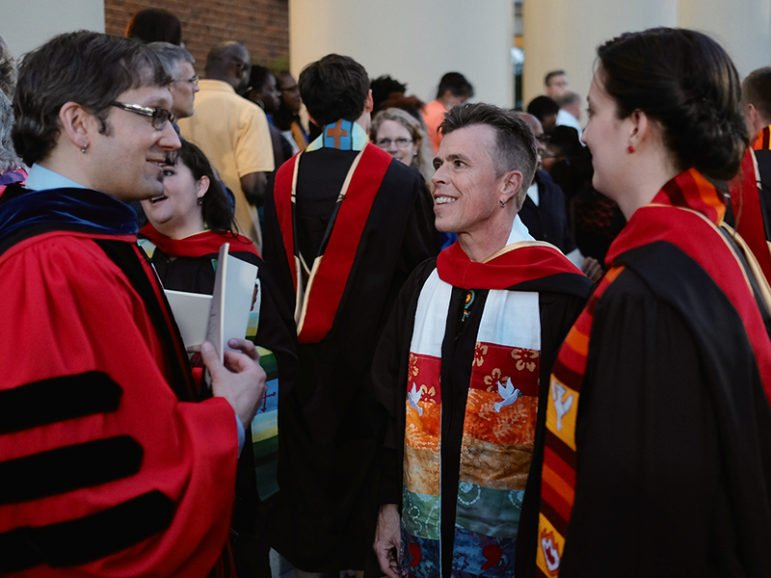 Liam Hooper (MDiv '15), center, converses with classmates and Dr. Clinton Moyer after receiving his Masters' Hood during the Wake Forest University School of Divinity's 2015 Hooding Ceremony on May 16 in Wait Chapel. Photo by G. Allen Aycock, courtesy of Wake Forest University School of Divinity