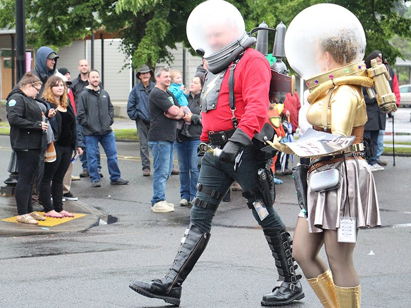 The UFO Parade marches through downtown McMinnville, Ore., during McMenamins UFO Festival on May 14, 2016. The festival regularly brings 7,000 to 10,000 people from as far away as Florida and Massachusetts to McMinnville, a city of 33,0000, though organizers said attendance was down a bit this year because of the rain. RNS photo by Emily McFarlan Miller