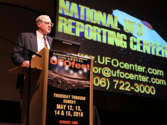 Peter Davenport, longtime director of the National UFO Reporting Center, speaks during McMenamins UFO Festival on May 14, 2016, at the McMinnville Community Center in McMinnville, Ore. RNS photo by Emily McFarlan Miller