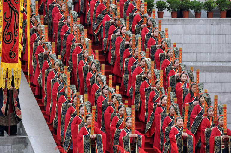 Participants wear traditional costumes at a celebration to worship Yellow Emperor Xuan Yuan, who is considered by many to be the ancestor of the Chinese, during Qingming Festival, also known as Tomb Sweeping Festival, in Hangling county, Shaanxi Province, China, April 4, 2016. Photo courtesy REUTERS/China Daily