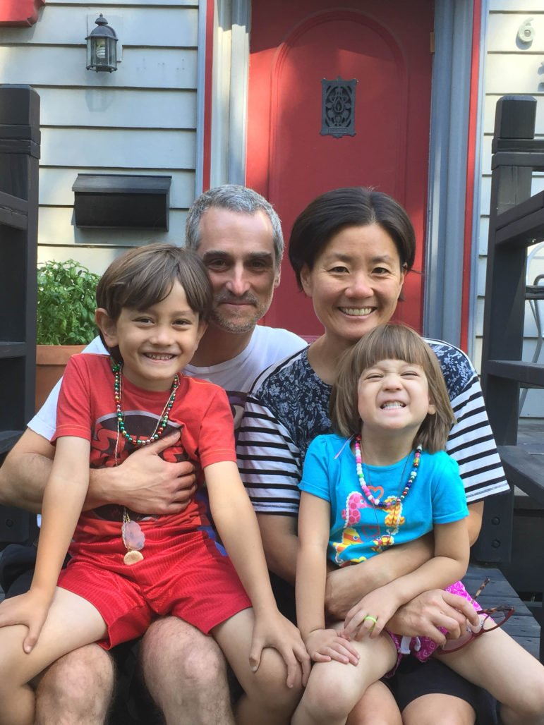 Helen Kim, Noah Leavitt, and their children Ari and Talia Kim-Leavitt, at home. Photo courtesy Kim-Leavitt family