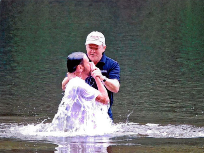 The Rev. Frank Page baptizes Stephen Allmond in 2008 at Paris Mountain State Park near Greenville, S.C. Photo courtesy of the Rev. Frank Page