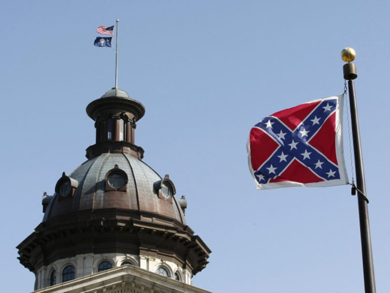 A Confederate flag flies at the base of a confederate memorial in front of the South Carolina State House in Columbia, South Carolina on July 4, 2015. Photo courtesy of REUTERS/Tami Chappell