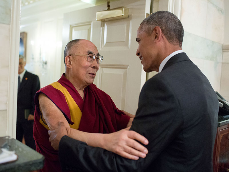 President Barack Obama greets His Holiness the Dalai Lama