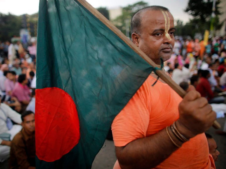 A Hindu monk holds a Bangladesh national flag  during a protest in Dhaka on Sept. 10, 2013. Photo courtesy REUTERS/Andrew Biraj