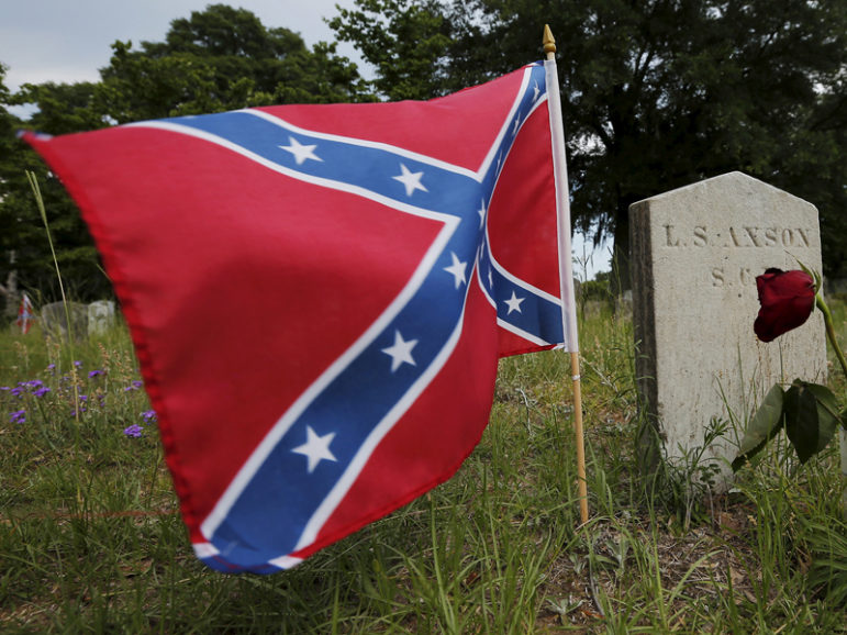 A Confederate battle flag flies at the grave of L.S. Axson, a soldier in the Confederate States Army in the U.S. Civil War, in Magnolia Cemetery in Charleston, S.C., on June 22, 2015. Photo courtesy of REUTERS/Brian Snyder