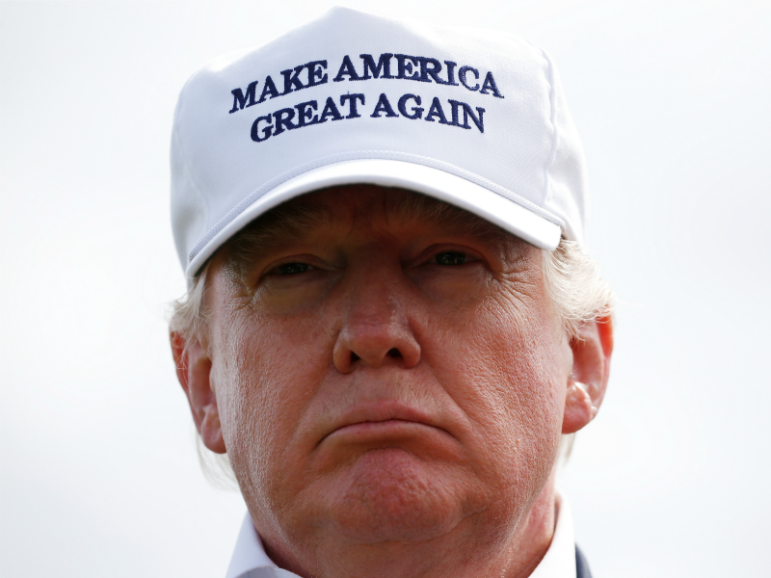 Republican presidential candidate Donald Trump speaks to the media June 25, 2016, on the golf course at his Trump International Golf Links in Aberdeen, Scotland. Photo courtesy of Reuters/Carlo Allegri