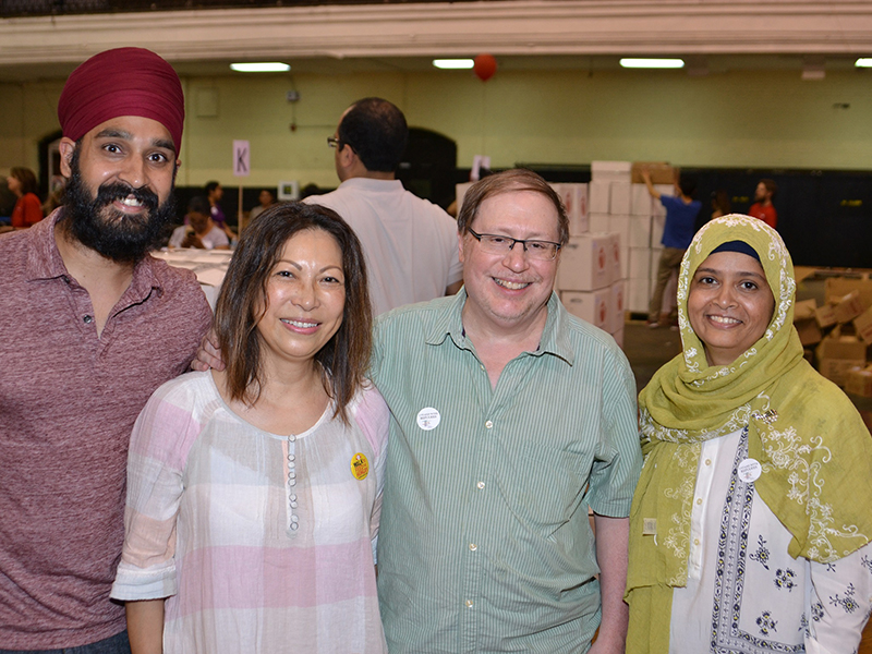 Left to right, Simran Jeet Singh of The Sikh Coalition, Sophie Sun of Buddhist Global Relief, Rabbi Eric J. Greenberg of the Mutlifaith Alliance for Syrian Refugees and Sarah Sayeed a senior advisor in the community affairs unit of New York Mayor Bill de Blasio's office, pose for a photo during an event to send personal hygiene care packages to Syrian refugees in Turkey. Photo courtesy of