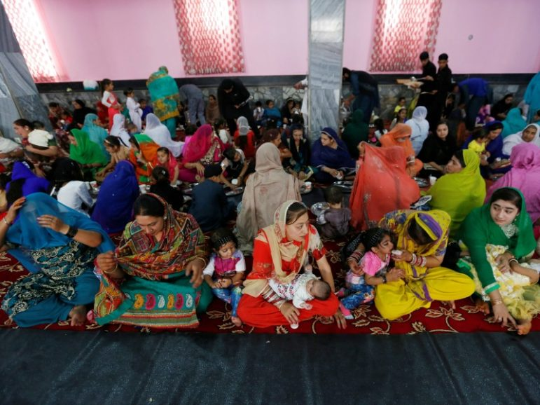 Afghan Hindu and Sikh families wait for lunch inside a Gurudwara, or a Sikh temple, during a religious ceremony June 8, 2016, in Kabul, Afghanistan. Photo by Mohammad Ismail/REUTERS