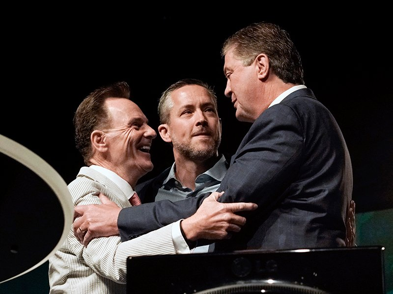 (Left to right) Outgoing Southern Baptist Convention President Ronnie Floyd together with presidential nominee J.D. Greear congratulate president-elect Steve Gaines, pastor of Bellevue Baptist Church in Cordova, Tenn., after he is elected president of the SBC by acclamation after Greear withdrew from the race and moved that the convention elect Gaines by acclamation during the SBC's annual meeting at America's Center in St. Louis Wednesday, June 15. Photo by Bill Bangham, courtesy of Baptist Press
