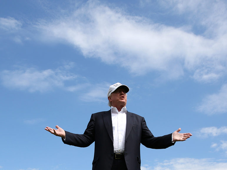 Republican presidential candidate Donald Trump speaks to the media on the golf course at his Trump International Golf Links in Aberdeen, Scotland, on June 25, 2016. Photo courtesy of Reuters/Carlo Allegri