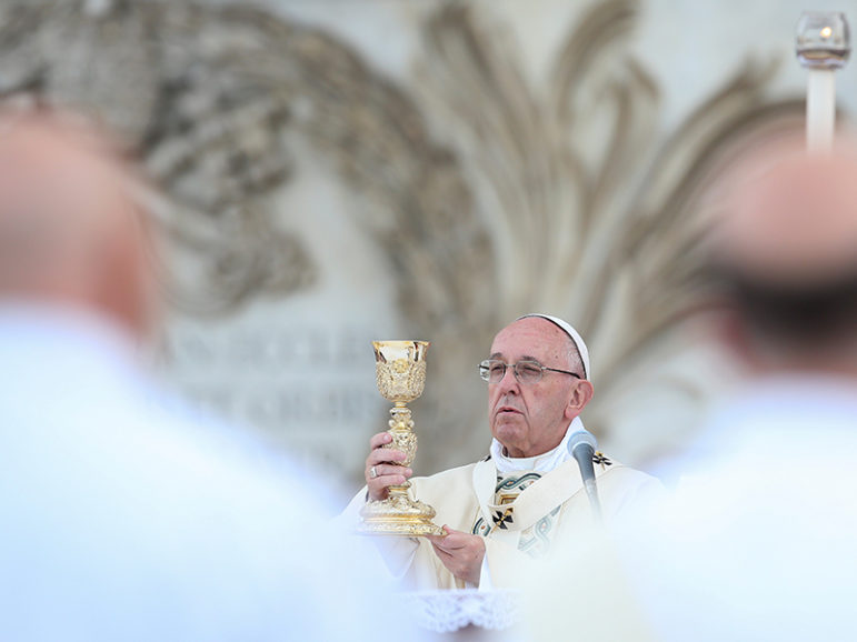 Pope Francis celebrates Mass during the Feast of Corpus Christi (Body of Christ) at St. Giovanni in Laterano Basilica, in Rome,  on May 26, 2016. Photo courtesy of REUTERS/Alessandro Bianchi *Editors: This photo may only be republished with RNS-CATHOLIC-GAYS, originally transmitted on June 30, 2016.