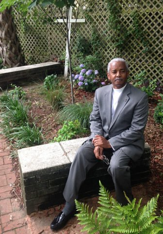 The Rev. Anthony Thompson, pastor of Holy Trinity Reformed Episcopal in Charleston, S.C., in a garden planted at his church in honor of his wife, Myra Thompson. A reverend herself and a congregant at Emanuel African Methodist Episcopal Church in Charleston, she died in the massacre at Bible study at Emanuel on June 17, 2015. Photo courtesy of the Rev. Anthony Thompson
