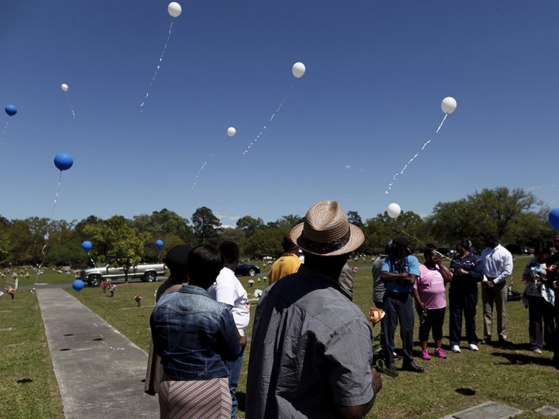Rodney Scott, center, brother of the late Walter Scott, watches as balloons are released as relatives and friends gathered to remember Scott, at Live Oak Memorial Gardens in Charleston, South Carolina, on April 4, 2016. Photo courtesy of REUTERS/Randal Hill *Editors: This photo may only be republished with RNS-CHARLESTON-ANNIVERSARY, originally transmitted on June 8, 2016.