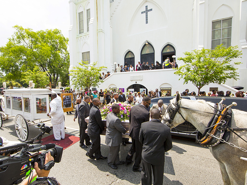 The casket of shooting victim Susie Jackson is brought into Emanuel AME Church for funeral services in Charleston, South Carolina on June 27, 2015. Photo courtesy of REUTERS/Jason Miczek *Editors: This photo may only be republished with RNS-CHARLESTON-ANNIVERSARY, originally transmitted on June 8, 2016.