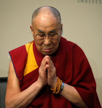 The Dalai Lama prays for the victims of the Orlando shootings before speaking at the U.S. Institute of Peace in Washington, D.C., on June 13, 2016. Photo courtesy of REUTERS/Kevin Lamarque