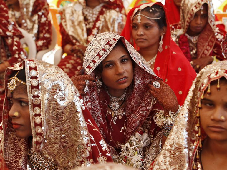 Muslim brides wait for the start of a mass marriage ceremony in Ahmedabad, India, on Oct. 11, 2015. Photo courtesy of REUTERS/Amit Dave *Editors: This photo may only be republished with RNS-MUSLIM-DIVORCE, originally transmitted on June 21, 2016.